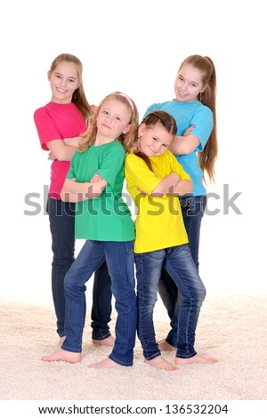 cheerful young girls in colored T-shirts on white background