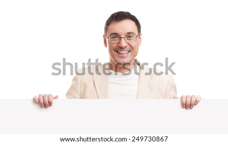 Cheerful young handsome man with blank signboard, isolated on white background