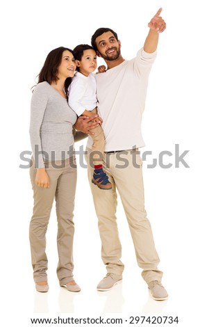 cheerful young indian family pointing on white background