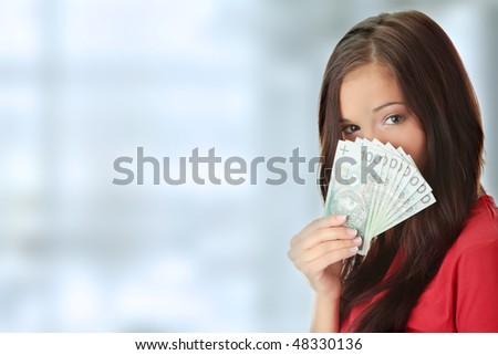 Cheerful young lady holding cash - stock photo
