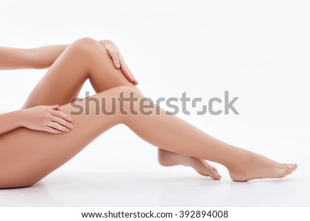 Cheerful young lady is caring of her skin - stock photo
