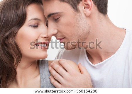Cheerful young lovers are resting at home - stock photo