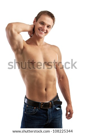 Cheerful young man in jeans with bare torso - stock photo