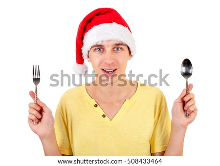 Cheerful Young Man in Santa Hat with Cutlery Isolated on the White Background
