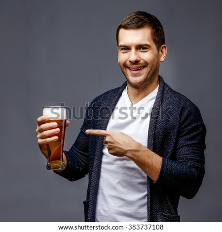 Cheerful young man in smart casual wear