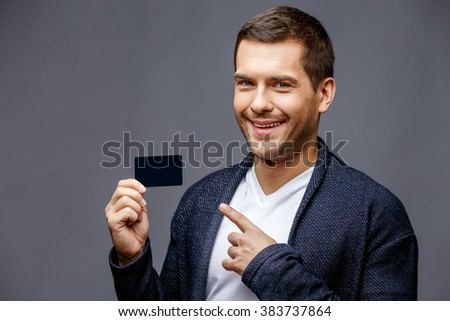 Cheerful young man in smart casual wear - stock photo