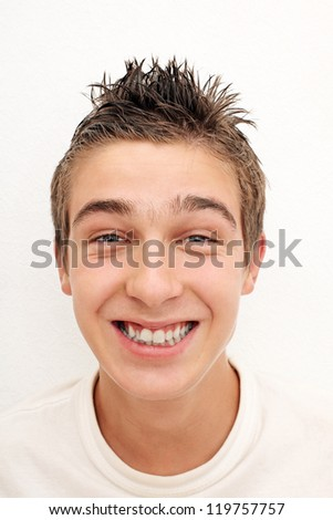 Cheerful Young Man Portrait on the White Wall background