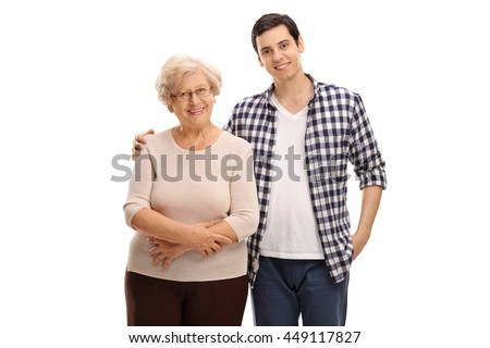 Cheerful young man posing together with his grandmother isolated on white background