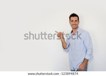 Cheerful young man showing message on whiteboard - stock photo