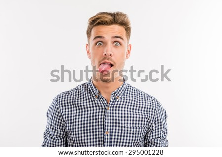 cheerful young man sticking his tongue out - stock photo