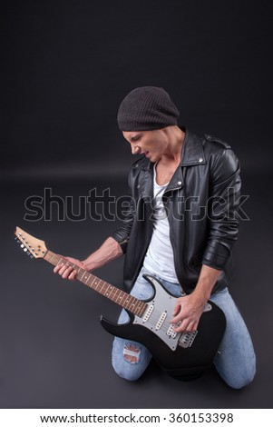 Cheerful young musician is making great performance - stock photo