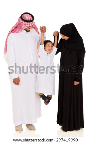 cheerful young muslim family having fun on white background - stock photo