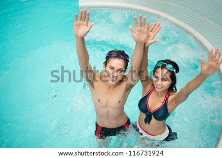 Cheerful young people enjoying bubbling water in jacuzzi