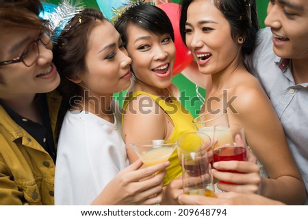 Cheerful young people having fun at the party - stock photo