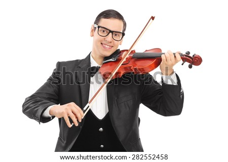 Cheerful young violinist playing an acoustic violin isolated on white background - stock photo