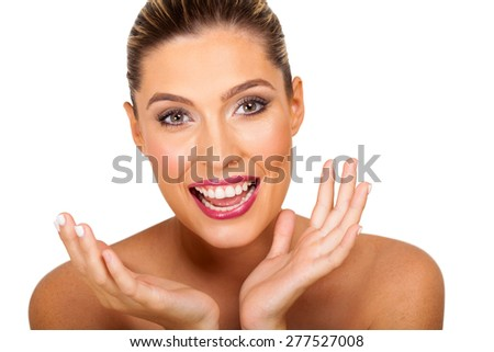 cheerful young woman beauty shot with surprised facial expression - stock photo