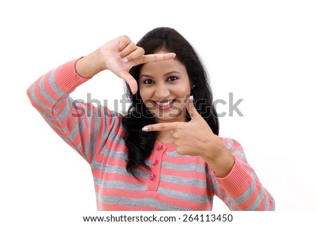 Cheerful young woman creating a frame with fingers - stock photo