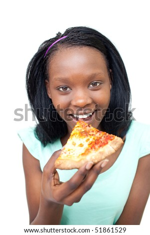 Cheerful young woman eating a pizza against a white background - stock photo