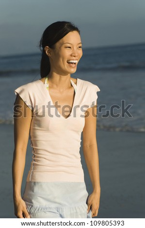 Cheerful young woman enjoying on a beach