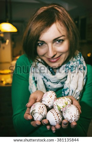 Cheerful young woman enjoying the Easter eggs. Spring celebration. Beauty and fashion. - stock photo