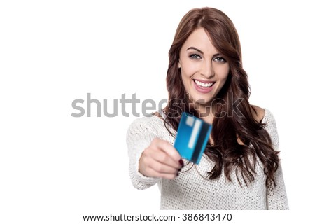 Cheerful young woman giving her credit card - stock photo