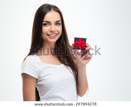 Cheerful young woman holding small gift box isolated on a white background and looking at camera - stock photo