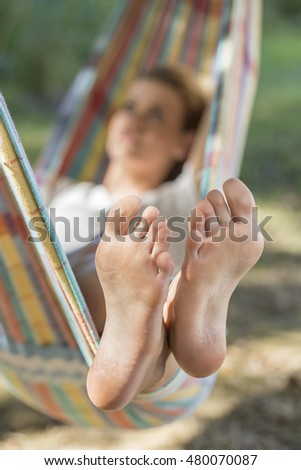 cheerful young woman  in a hammock