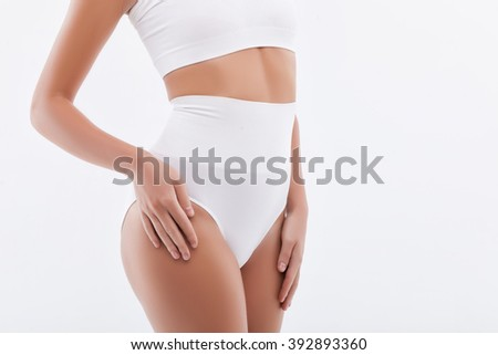 Cheerful young woman is boasting of her figure - stock photo