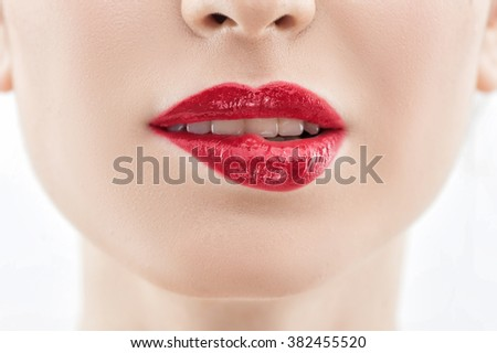 Cheerful young woman is deducing with her mouth - stock photo