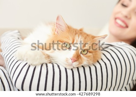 Cheerful young woman is relaxing with pet - stock photo