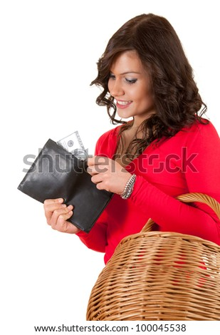 cheerful young woman looking to the wallet with dollars, white background
