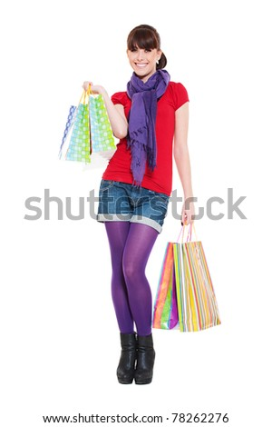 cheerful young woman with shopping bags against white background - stock photo