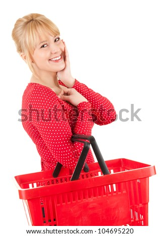 cheerful young woman with shopping basket, white background