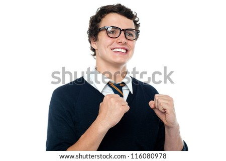 Cheerful youngster celebrating his success. Expressing happiness - stock photo
