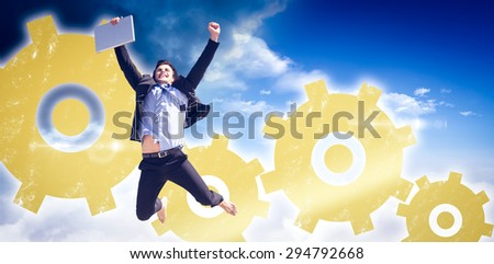 Cheering businessman against bright blue sky with clouds - stock photo