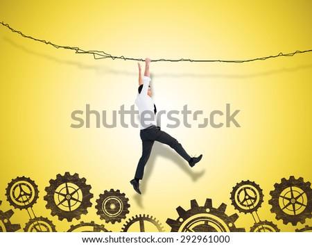 Cheering businessman against yellow vignette - stock photo