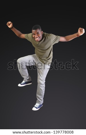Cheering dancing man with big smile - stock photo