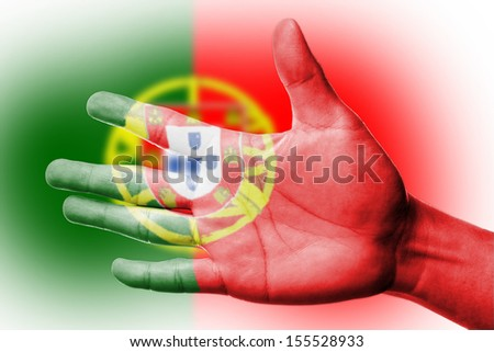 Cheering fan with Painting national Portugal   flag with your hand with your hand for cheer your national sport