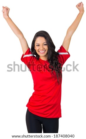Cheering football fan in red on white background - stock photo