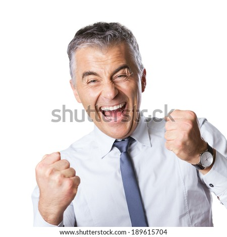 Cheering happy businessman with fists raised on white background. - stock photo