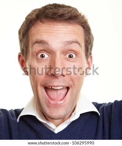 Cheering happy man looking really happy into the camera - stock photo