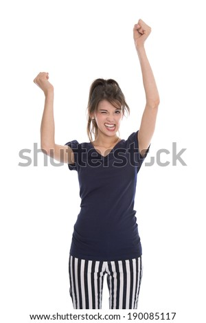 Cheering happy young successful woman with hands up.