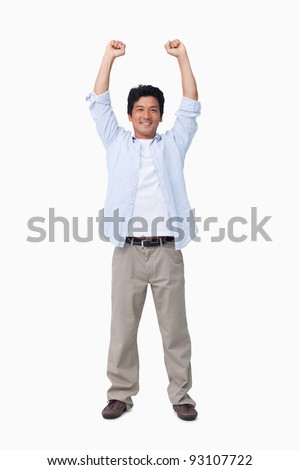 Cheering male with arms up against a white background - stock photo