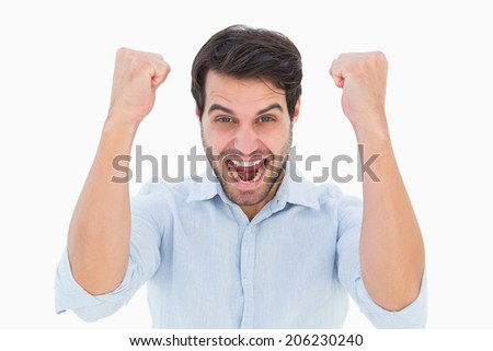Cheering man looking at camera on white background - stock photo