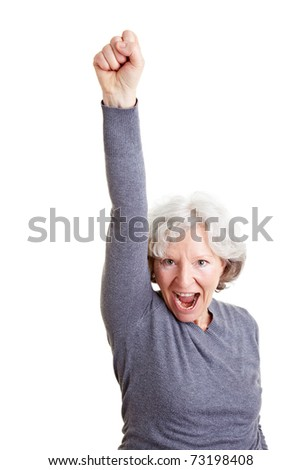 Cheering old senior woman clenching her fist - stock photo