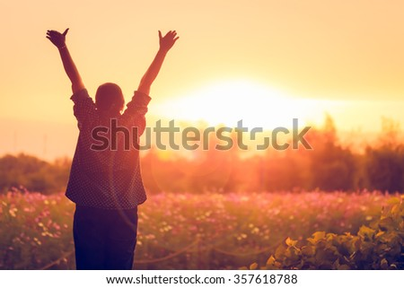 cheering woman open arms at sunrise flowers garden,Nature of Life - stock photo