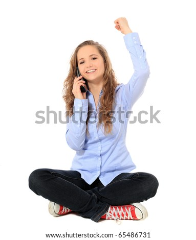 Cheering young girl making a phone call. All on white background.