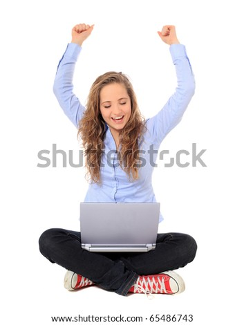 Cheering young girl using notebook computer. All on white background.