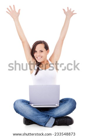 Cheering young woman with laptop. All on white background.