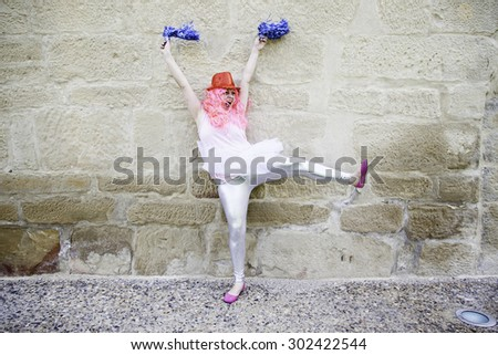 Cheerleader party woman dancing and jumping, joy - stock photo